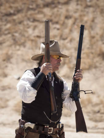 Cowboy Action Shooting Club. The firearms used are based on those which existed in the 19th century American West, i.e. lever action rifle, single action revolver, and shotgun. Stock Photo - 13118355