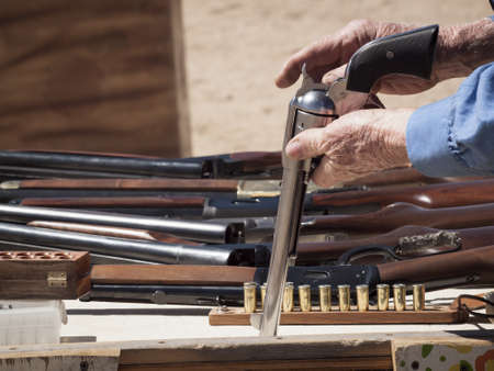 Cowboy Action Shooting Club. The firearms used are based on those which existed in the 19th century American West, i.e. lever action rifle, single action revolver, and shotgun. Stock Photo - 13118588
