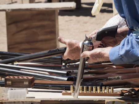 Cowboy Action Shooting Club. The firearms used are based on those which existed in the 19th century American West, i.e. lever action rifle, single action revolver, and shotgun. Stock Photo - 13118591