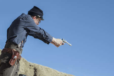 Cowboy Action Shooting Club. The firearms used are based on those which existed in the 19th century American West, i.e. lever action rifle, single action revolver, and shotgun. Stock Photo - 13118274