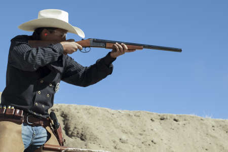 Cowboy Action Shooting Club. The firearms used are based on those which existed in the 19th century American West, i.e. lever action rifle, single action revolver, and shotgun. Stock Photo - 13118282