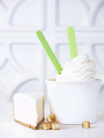 Cup of cheesecake frozen yogurt or soft serve ice cream. photo