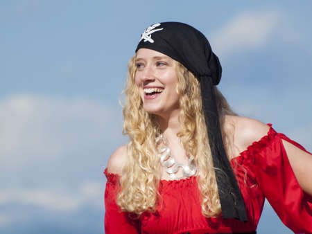 Beautiful young female pirate in red dress. Stock Photo - 13199687
