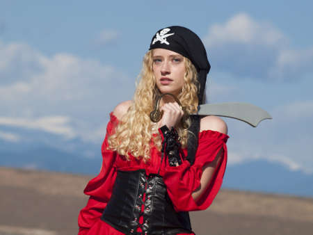 Beautiful young female pirate in red dress. Stock Photo - 13199678