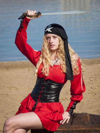 Beautiful young female pirate in red dress. Stock Photo - 13199153