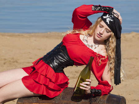 Beautiful young female pirate in red dress. Stock Photo - 13199128