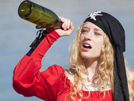 Beautiful young female pirate in red dress. Stock Photo - 13199106