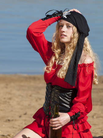 Beautiful young female pirate in red dress. Stock Photo - 13199172