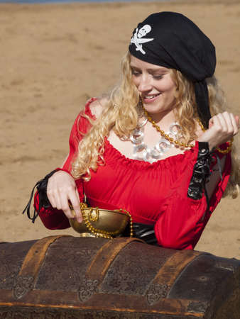 Beautiful young female pirate in red dress. Stock Photo - 13198989