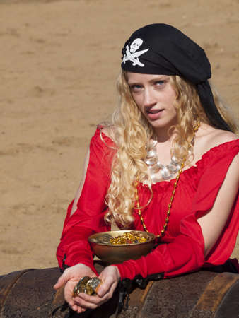 Beautiful young female pirate in red dress. Stock Photo - 13199054