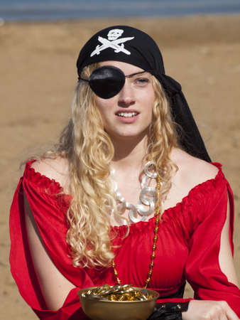 Beautiful young female pirate in red dress.