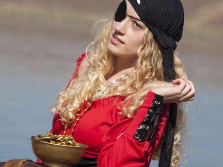 Beautiful young female pirate in red dress. Stock Photo - 13199121