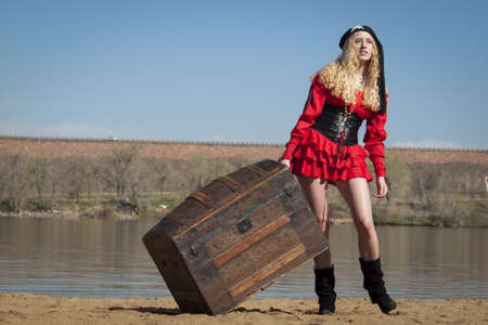 dragging: Beautiful young female pirate in red dress.