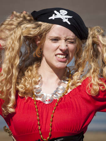 Beautiful young female pirate in red dress. Stock Photo - 13198918