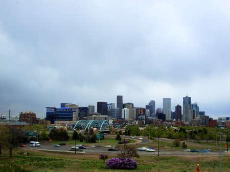 denver skyline with mountains: Denver skyline at blue hour.