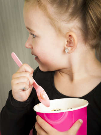 Young ballerinas having fun with frozen soft served yougurt. Stock Photo - 13375275