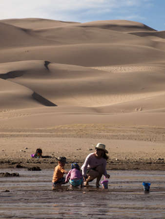 Spring at Great Sand Dunes National Park, Colorado. Medano Creek flows around the base of the dunes in springtime.