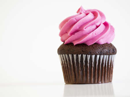 White and pink cupcakes on a white background.
