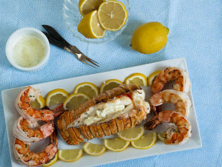 lobster tail: Lobster tail and jumbo shrimps with lemon and butter.