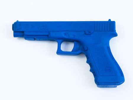 molded: Training Glock 34 Blue Gun on white background. Editorial