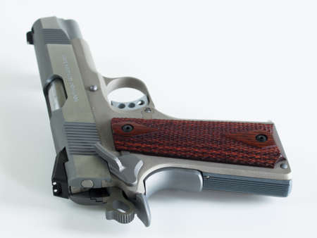 Colt 1911 Commander is a single-action, semi-automatic, magazine-fed, and recoil-operated handgun based on the John M. Browning designed M1911. It was the first mass-produced pistol with an aluminium alloy frame and the first Colt pistol to be chambered i