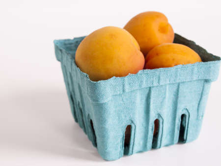 The apricot fruit is a drupe similar to a small peach, from yellow to orange, often tinged red on the side most exposed to the sun; its surface can be smooth or velvety with very short hairs. The flesh is usually firm and not very juicy.Its taste can rang Stock Photo - 13700083