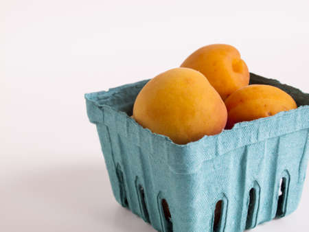 The apricot fruit is a drupe similar to a small peach, from yellow to orange, often tinged red on the side most exposed to the sun; its surface can be smooth or velvety with very short hairs. The flesh is usually firm and not very juicy.Its taste can rang Stock Photo - 13700136