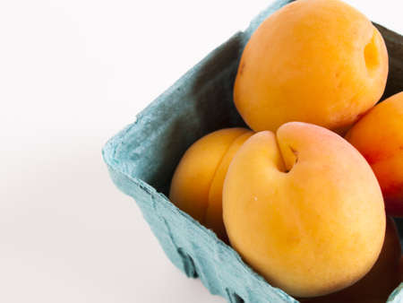 The apricot fruit is a drupe similar to a small peach, from yellow to orange, often tinged red on the side most exposed to the sun; its surface can be smooth or velvety with very short hairs. The flesh is usually firm and not very juicy.Its taste can rang Stock Photo - 13700066