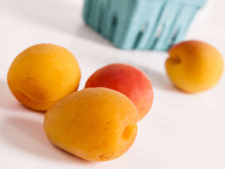 The apricot fruit is a drupe similar to a small peach, from yellow to orange, often tinged red on the side most exposed to the sun; its surface can be smooth or velvety with very short hairs. The flesh is usually firm and not very juicy.Its taste can rang Stock Photo - 13700031