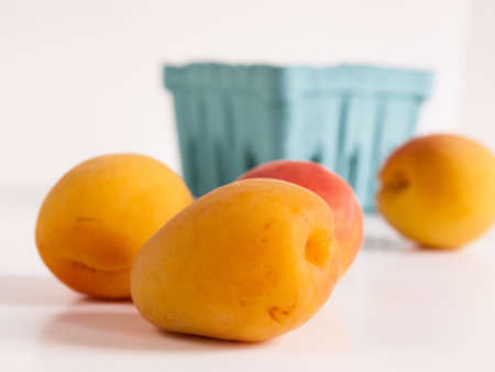 The apricot fruit is a drupe similar to a small peach, from yellow to orange, often tinged red on the side most exposed to the sun; its surface can be smooth or velvety with very short hairs. The flesh is usually firm and not very juicy.Its taste can rang Stock Photo - 13700005