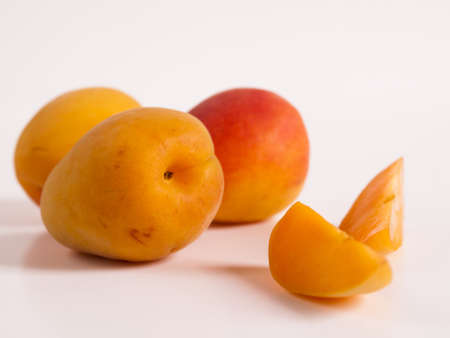 The apricot fruit is a drupe similar to a small peach, from yellow to orange, often tinged red on the side most exposed to the sun; its surface can be smooth or velvety with very short hairs. The flesh is usually firm and not very juicy.Its taste can rang Stock Photo - 13699981