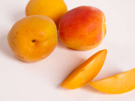 The apricot fruit is a drupe similar to a small peach, from yellow to orange, often tinged red on the side most exposed to the sun; its surface can be smooth or velvety with very short hairs. The flesh is usually firm and not very juicy.Its taste can rang Stock Photo - 13700020
