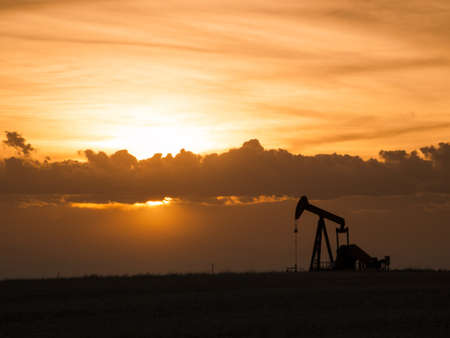 horsehead pump: A pumpjack silhoutte with dramatic sunset.