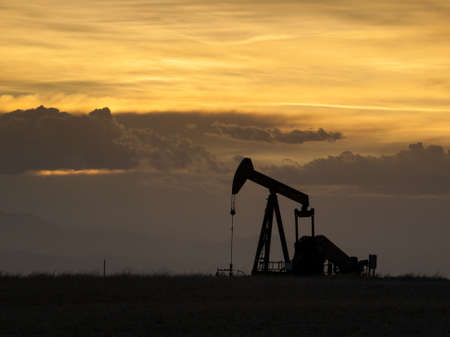 A pumpjack silhoutte with dramatic sunset. Stock Photo - 13998910