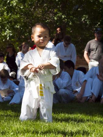 tae: 2012 J. W. Kim Tae Kwon Do school belt test in the park. Editorial