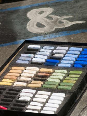 Chalks on the street during Chalk Art Festival in Denver, Colorado. photo