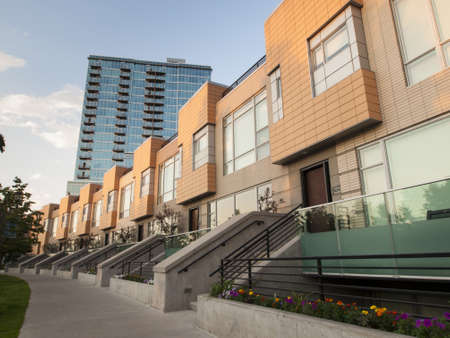 townhome: Riverfront development at sunset in Denver, Colorado. Editorial