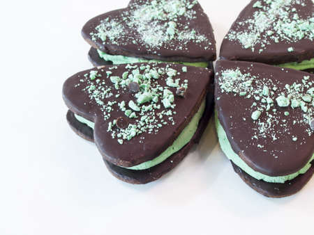 Chocolate cookies with mint filling on white background. photo