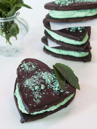 Chocolate cookies with mint filling on white background. Stock Photo - 14047205