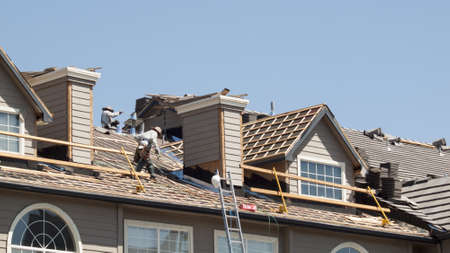 fixing: Roof repairs of an apartment building in Colorado. Editorial