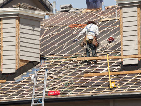 thatcher: Roof repairs of an apartment building in Colorado. Editorial