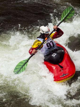 Kayak freestyle event  at 2012 Summer Teva Mountain Games. Vail, Colorado. Stock Photo - 14142442