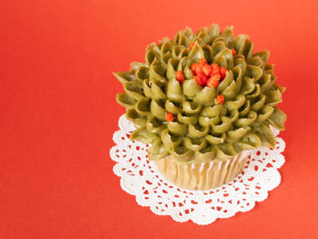 Gourmet reen tea cupcake on red backround. photo