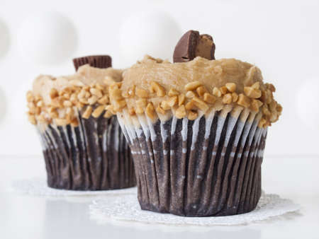 reese's: Gourmet Reeses peanut butter cups cupcake on white backround. Stock Photo