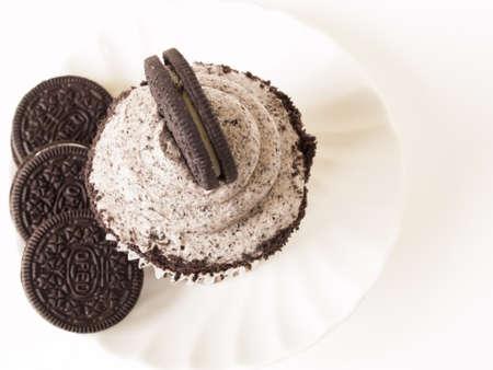 baked treat: Gourmet Oreo cupcake on white backround.