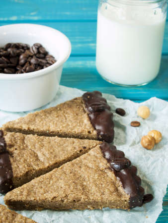 cobnut: Gourmet hazelnut and coffee chocolate bars on white parchment paper. Stock Photo