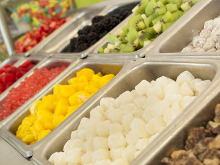 caneberries: Frozen yogurt toppings bar. Yogurt toppings ranging from fresh fruits, nuts, fresh-cut candies, syrups and sprinkles. Stock Photo