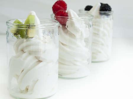 Frozen soft-serve yogurt in cup on white background. photo