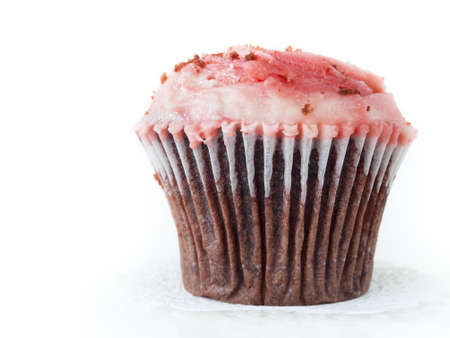Gourmet red welveet cupcake on white background. photo