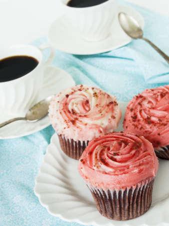 patty cake: Gourmet red welveet cupcake on white plate.